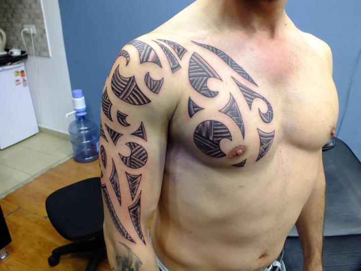 Shoulder Arm Tribal Tattoo by Yusuf Artik Tattoo Studio