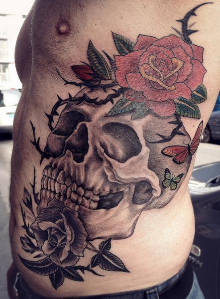 Flower Side Skull Tattoo by Løkka Tattoo Lounge