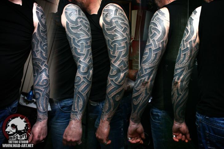Tribal Sleeve Tattoo by Mad-art Tattoo