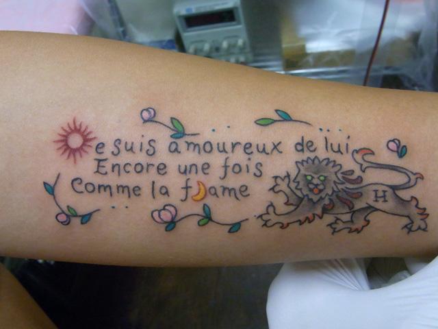 Arm Fantasy Lettering Tattoo by Daichi Tattoos & Artworks