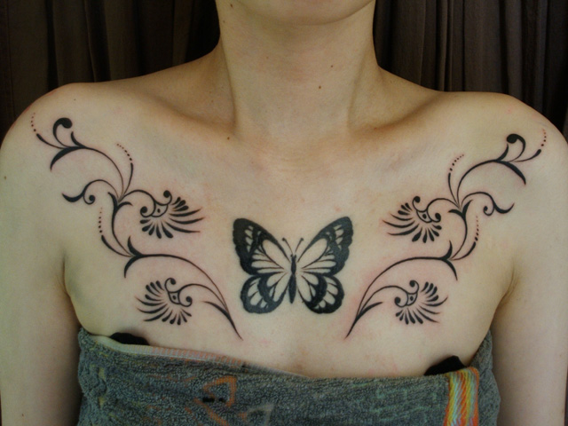 Butterfly Tribal Breast Tattoo by Daichi Tattoos & Artworks