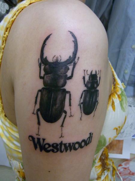 Shoulder Beetle Tattoo by Daichi Tattoos & Artworks