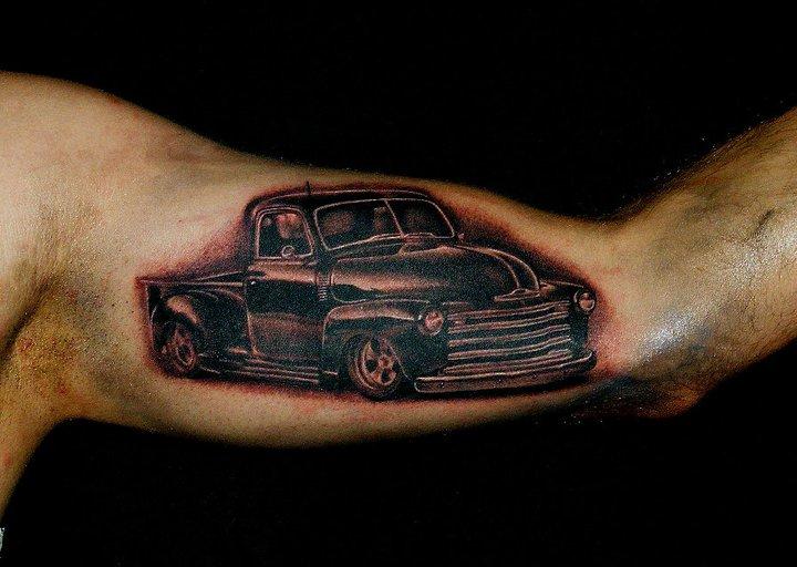 Arm Realistic Car Tattoo by Da Silva Tattoo