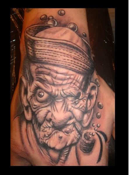 Fantasy Hand Character Tattoo by Tattoo Studio 73