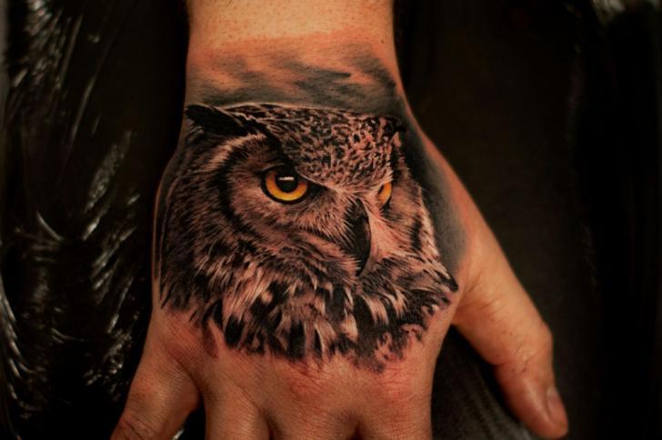 Realistic Hand Owl Tattoo by Tattoo Studio 73