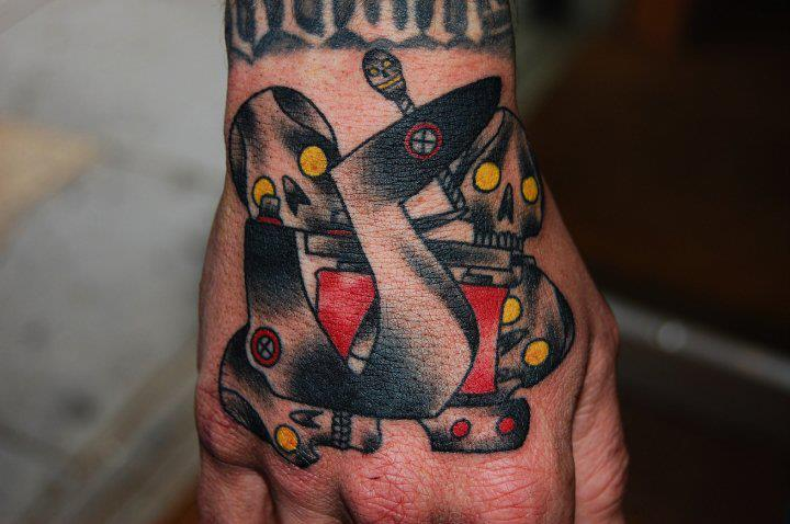 Old School Skull Hand Tattoo Machine Tattoo by Marked For Life