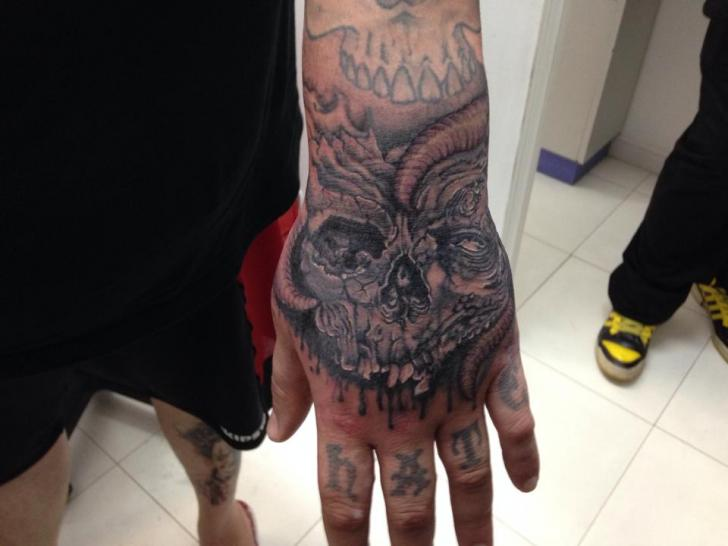 Skull Hand Tattoo by Dr Mortiis Tattoo Clinic