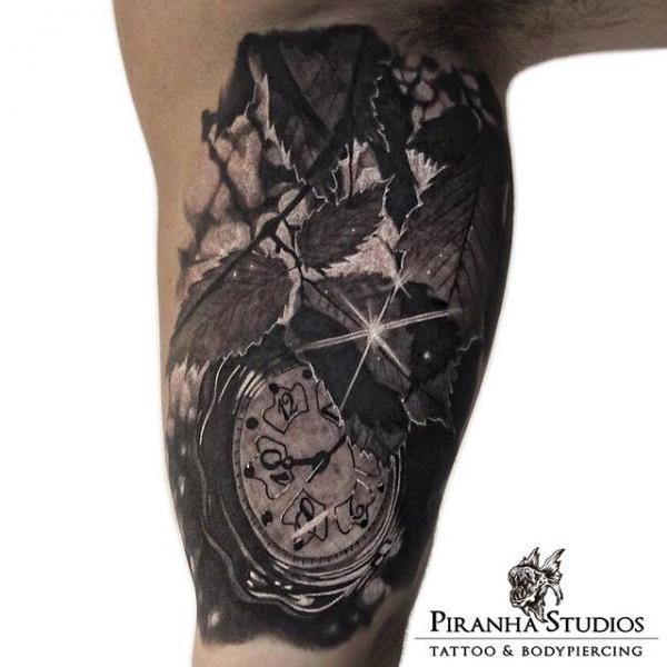 Arm Clock Leaf Tattoo by Piranha Tattoo Studio