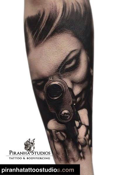 Arm Realistic Women Gun Tattoo by Piranha Tattoo Studio