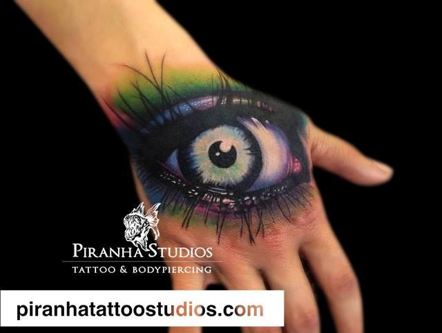 Hand Eye Tattoo by Piranha Tattoo Studio