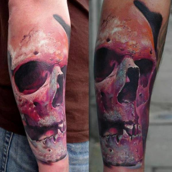 Arm Skull Tattoo by Piranha Tattoo Studio