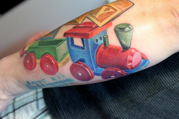 Arm Train Toy Tattoo by Electrographic Tattoo