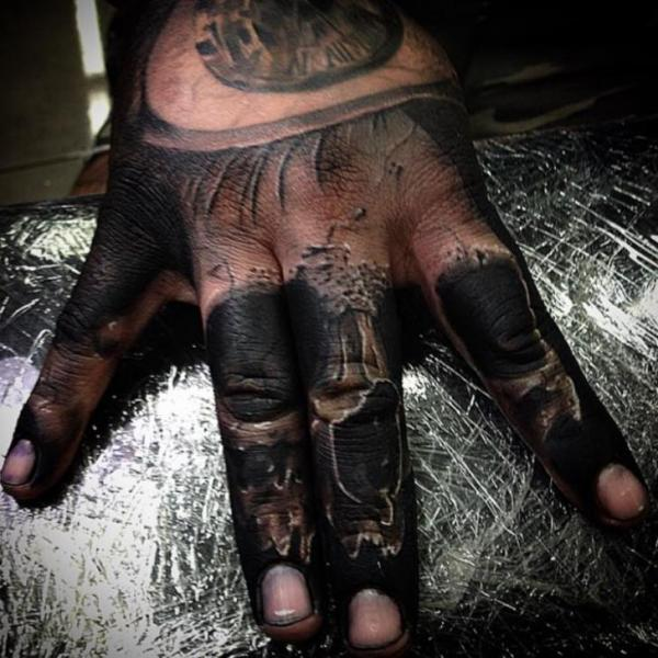 Finger Skull Hand Tattoo by Drew Apicture