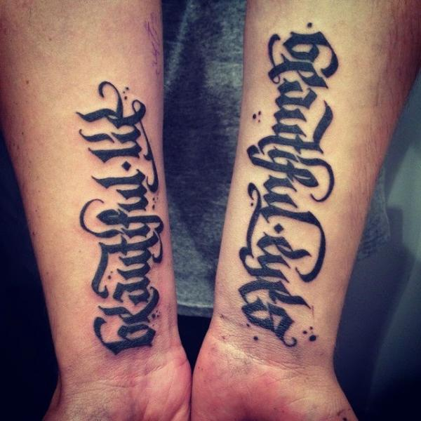 Arm Lettering Tattoo by Rock n Ink Tattoo