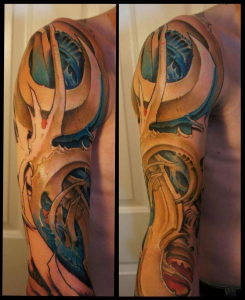 Shoulder Arm Biomechanical Tattoo by White Rabbit Tattoo