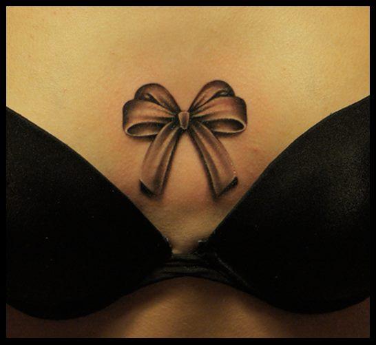 Ribbon Breast Tattoo by White Rabbit Tattoo