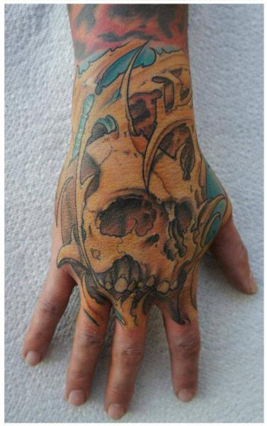 Skull Hand Tattoo by White Rabbit Tattoo