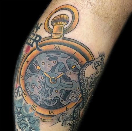 Arm Clock Tattoo by Devils Ink Tattoo