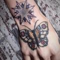 Old School Hand Butterfly tattoo by Hidden Moon Tattoo