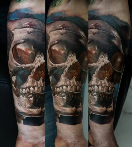Arm Realistic Skull Tattoo by Domantas Parvainis
