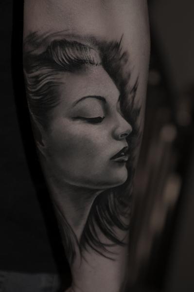 Arm Portrait Realistic Tattoo by Pawel Skarbowski