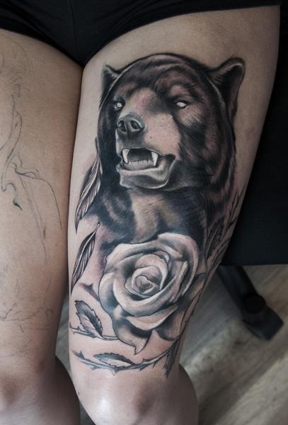 Realistic Flower Bear Thigh Tattoo by Pawel Skarbowski
