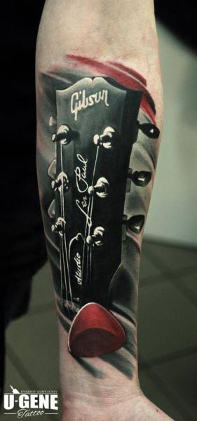 Arm Realistic Guitar Tattoo by Redberry Tattoo