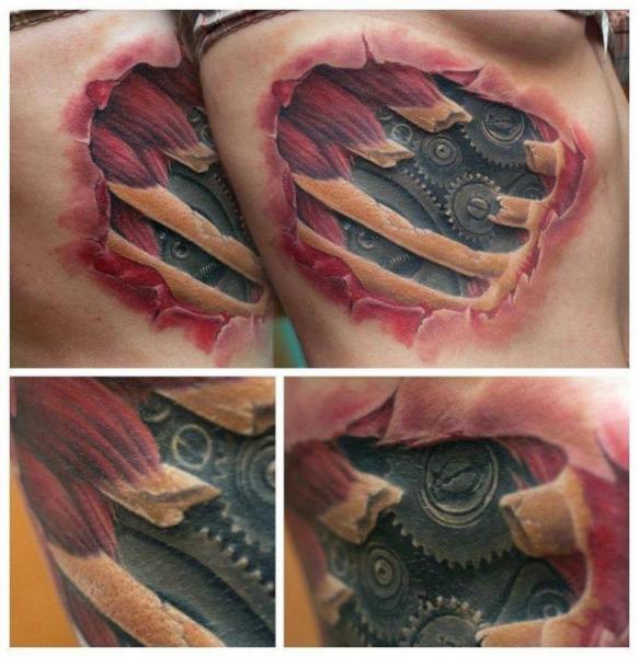 Tatuaje Biomecánica Lado Cicatriz por Redberry Tattoo