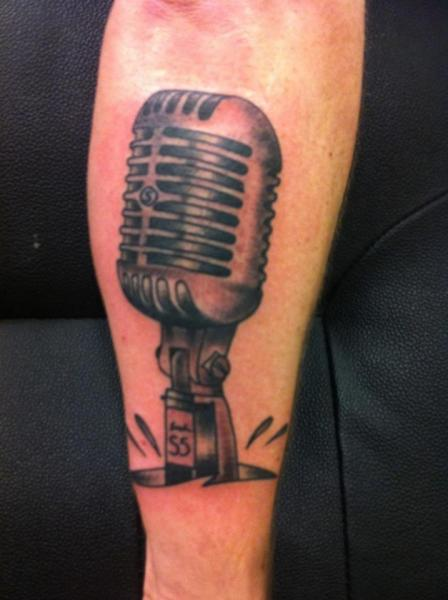 Arm Realistic Microphone Tattoo by Amigo Ink