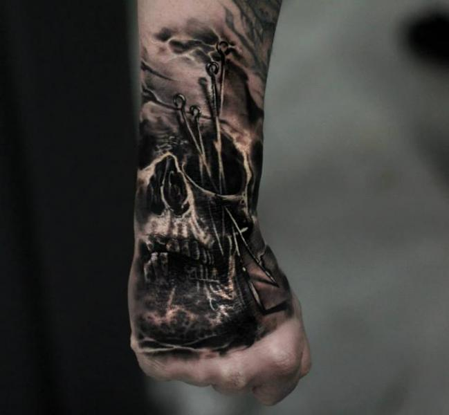 Skull Hand Tattoo by Matthew James