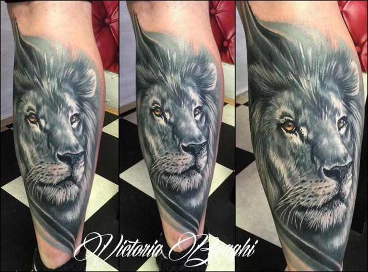 Realistic Calf Lion Tattoo by Victoria Boaghi