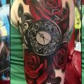 Shoulder Clock Flower tattoo by Victoria Boaghi