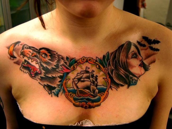 Old School Women Wolf Breast Ship Tattoo by Fairlane Tattoo