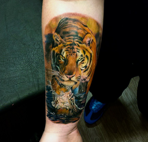 Arm Realistic Tiger Tattoo by Sacred Art Tattoo