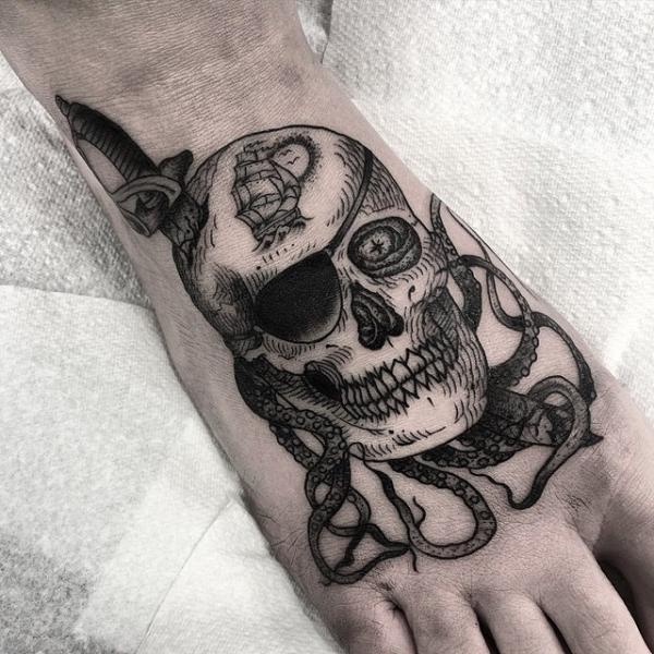 Foot Skull Dagger Tattoo by Sacred Art Tattoo