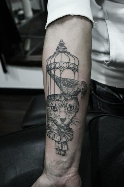 Arm Cat Bird Cage Tattoo by Ottorino d'Ambra