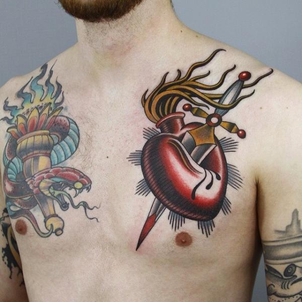 Chest Heart Dagger Tattoo by Sacred Tattoo Studio