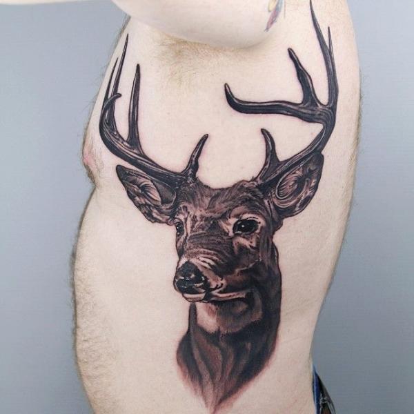 Realistic Side Deer Tattoo by Sacred Tattoo Studio