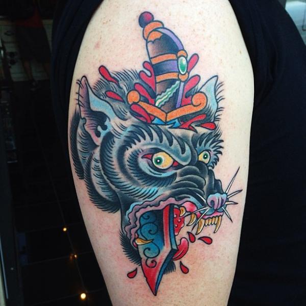 Shoulder Wolf Dagger Tattoo by Captured Tattoo