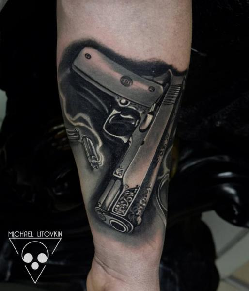 Arm Realistic Gun Tattoo by Michael Litovkin