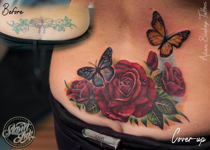 Realistic Flower Back Butterfly Tattoo by Slawit Ink