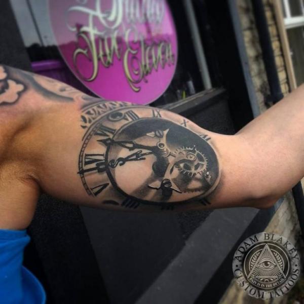 Arm Clock Tattoo by Slawit Ink