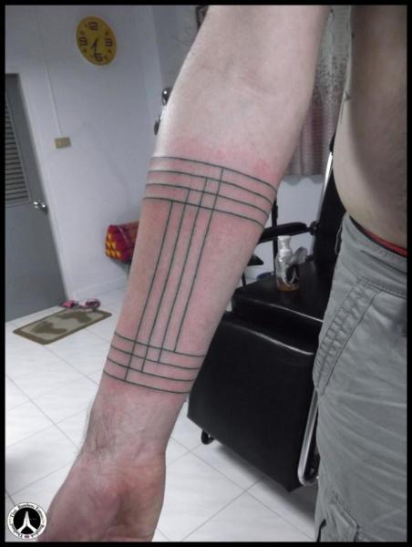 Arm Line Tattoo by Thai Bamboo Tattoo