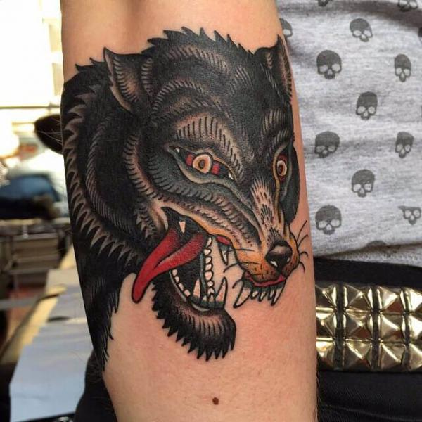 Arm Wolf Tattoo by Cloak and Dagger Tattoo