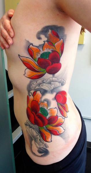 Flower Side Lotus Tattoo by Dalmiro Tattoo