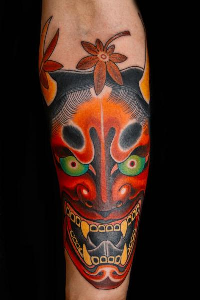 Arm Japanese Mask Tattoo by Kings Avenue Tattoo
