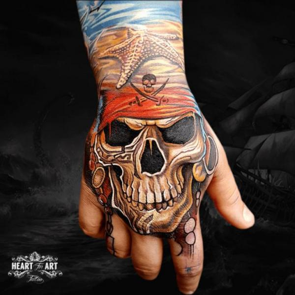 Skull Hand Tattoo By Heart Of Art