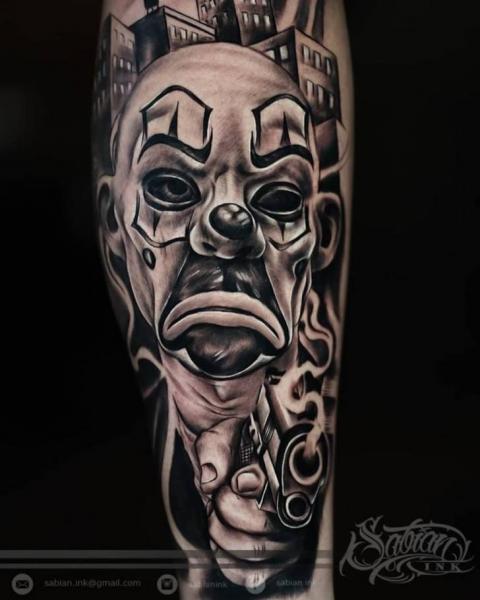 Arm Clown Gun Tattoo by Sabian Ink