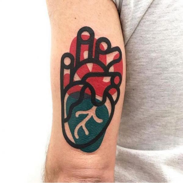Tatuaggio Braccio Cuore di Mambo Tattooer