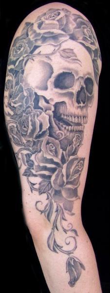 Arm Realistic Skull Flowers Tattoo by Cia Tattoo